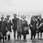 Beachgoers in swimsuits at Long Beach, Los Angeles, California around 1910.