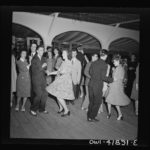 Numerous rules of etiquette governed dancing by men and women throughout history. What rules of etiquette were the men and women in this photograph expected to follow related to invitations, clothing, and behavior before, during and after the dance? Compare those expectations for behavior to modern dancing etiquette. In the past and today, how are people treated that do not conform?