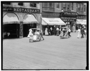 Wheel chairs or rolling chairs on the boardwalk, Atlantic City, New Jersey between 1905 and 1920. Photo by Detroit Publishing Co., Publisher. Courtesy of the Library of Congress.