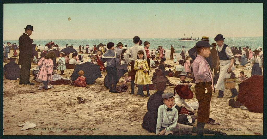 On the beach at Coney Island, 1902 by Detroit Photographic Co. Detroit Photographic Co. On the beach at COn the beach at Coney Island, 1902 by Detroit Photographic Co.Retrieved from the Library of Congress, https://www.loc.gov/item/2008678167/.