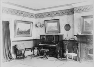 A piano was an important symbol of middle class status in the late nineteenth century parlor.